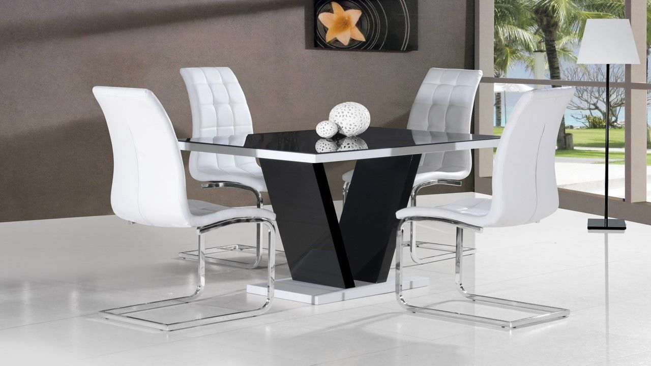 black glass high gloss dining table and 4 chairs in black On black and white dining table set