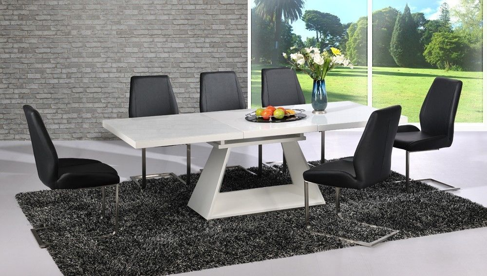 Modern white high gloss extending dining table and 8 black for Modern black dining table