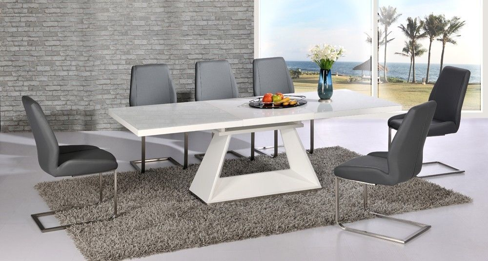 high gloss extending dining table and 6 grey chairs with glass top