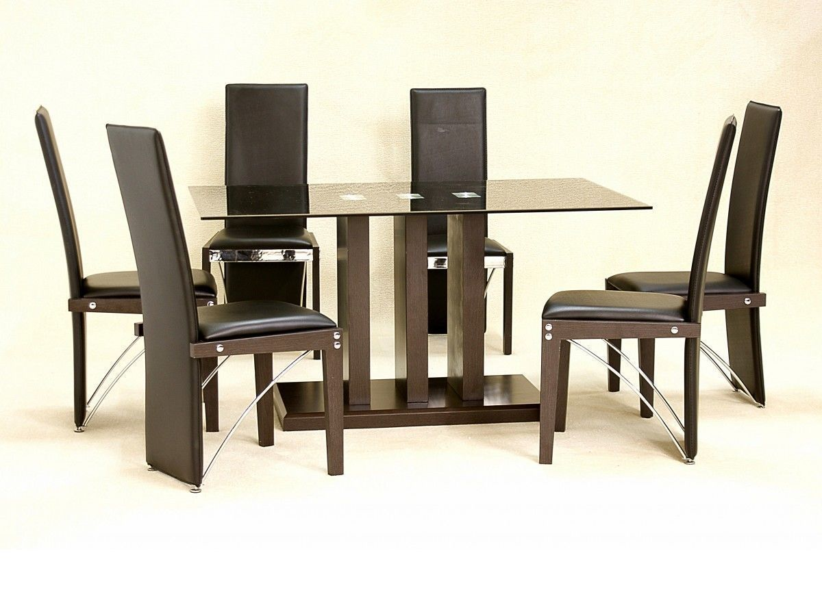 Black glass dining table and 6 chairs large homegenies for Black glass dining table