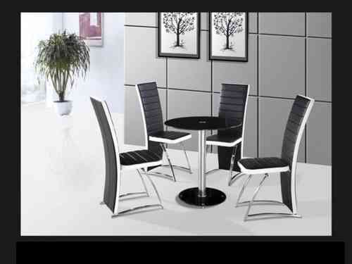 Round glass dining table and 4 black and white chairs set