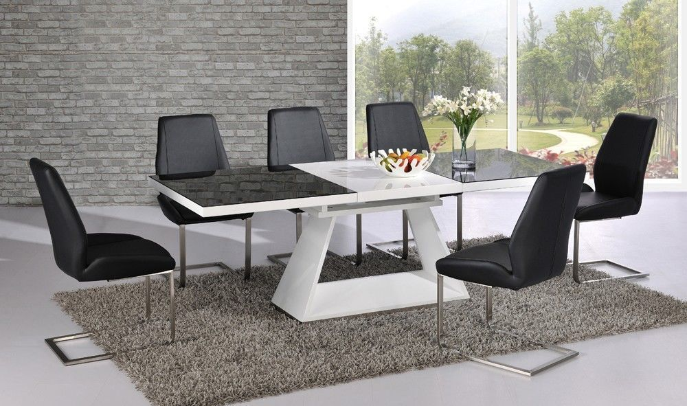 white high gloss extending dining table with 8 chairs set with black