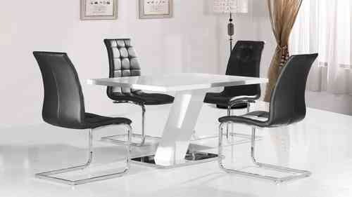White high gloss dining table and 4 black chairs with chrome base
