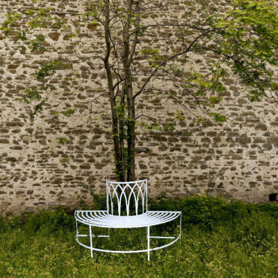 Cream metal tree seat bench
