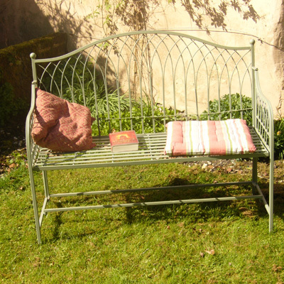 Green vintage metal garden bench