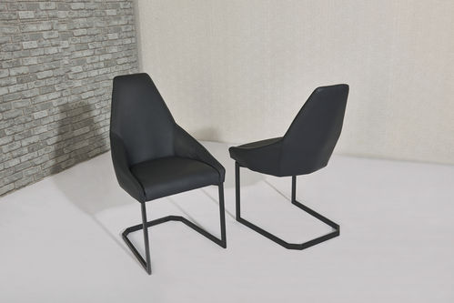 Shaped black faux leather dining chairs