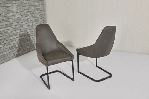 Grey fabric dining chairs with shaped back