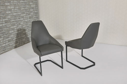 Grey faux leather dining chairs with shaped back