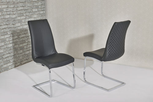 Black leather dining chairs with pattern backs