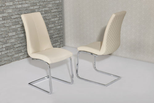 Cream faux leather dining chairs with pattern backs