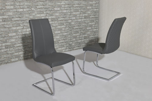 Grey faux leather dining chairs with pattern backs