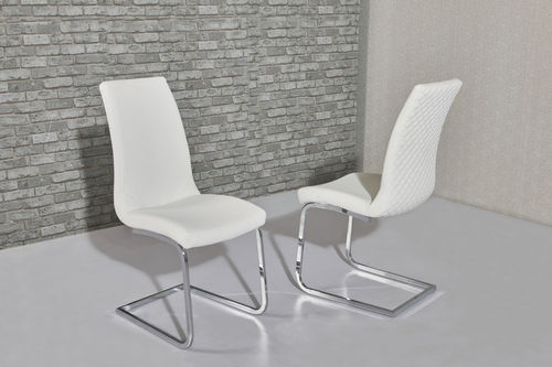 White faux leather dining chairs with pattern backs