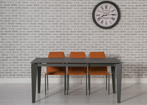 Extending grey glass dining table and 4 orange chairs