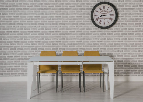 Extending white glass dining table and 4 yelow chairs
