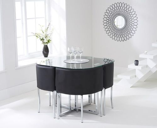 Spacesaver glass dining table and 4 black chairs