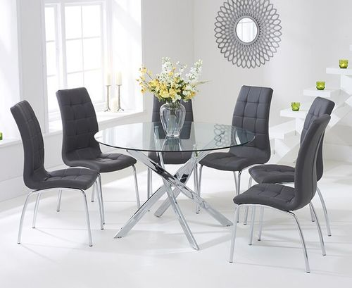 120cm round glass dining table and 6 grey chairs