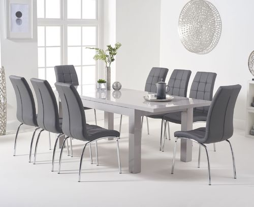 Extending light grey high gloss dining table and 8 chairs