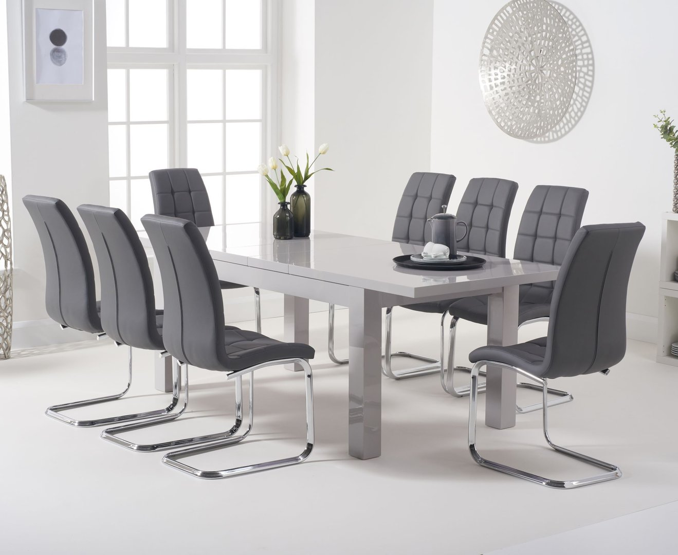 Extending light grey dining table and 9 grey chairs   Homegenies