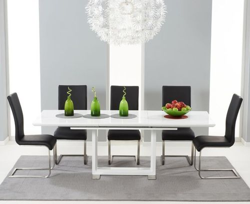 Extendable white high gloss dining table with 8 black chairs