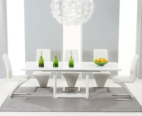 Extending white high gloss dining table and 8 Ivory Chairs