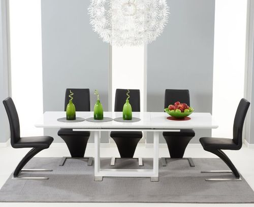 Extending white high gloss dining table and 8 black Z Chairs