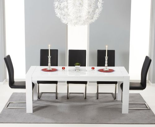 Extending white high gloss dining table and 12 black chairs
