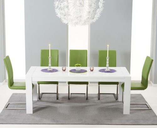 Extending white high gloss dining table and 12 green chairs