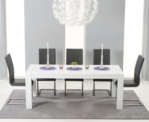 Extending white high gloss dining table and 12 grey chairs