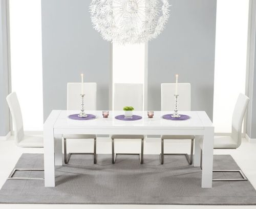 Extending white high gloss dining table and 12 white chairs