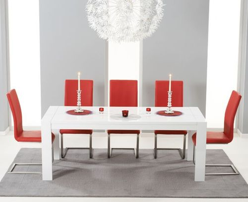 Extending white high gloss dining table and 12 red chairs