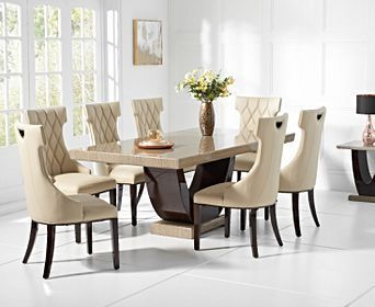 Light brown marble dining table with 8 cream chairs