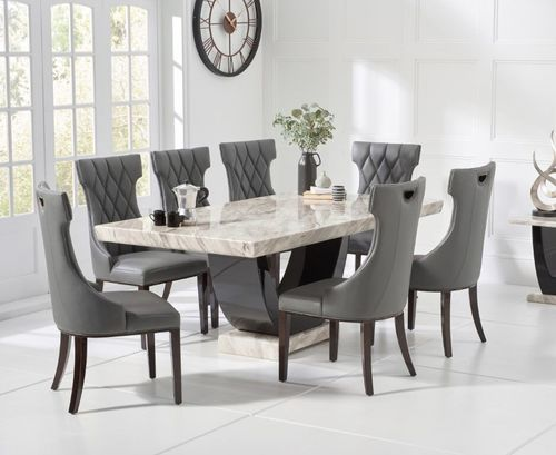 Cream marble dining table and 8 grey chairs