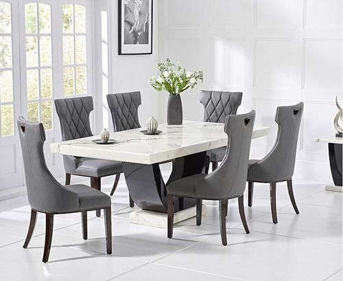 White marble dining table and 6 pattern backed chairs