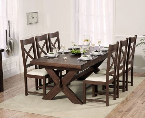 Dark oak dining table and 8 cream leather chairs