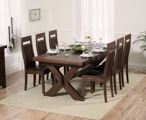 Dark oak dining table and 8 brown leather chairs