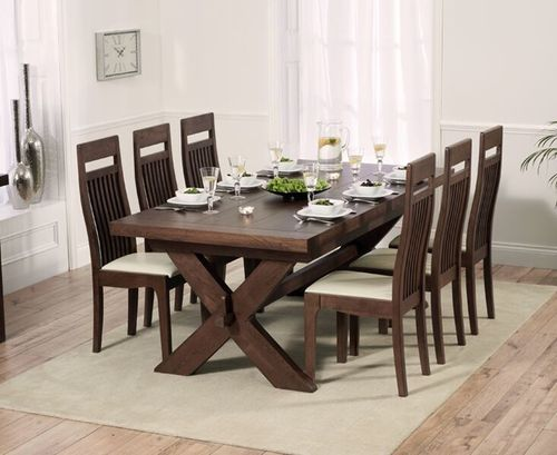 Dark oak dining table with 8 leather chairs