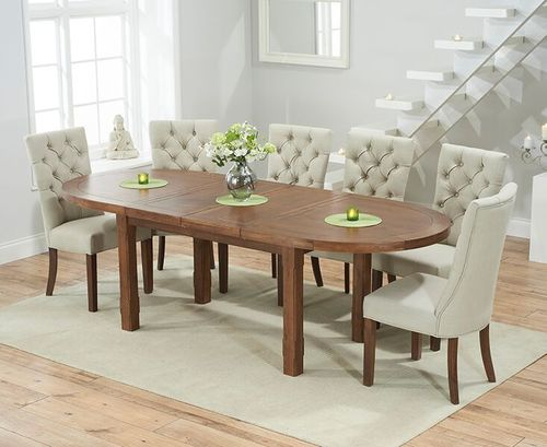 Dark oak dining table and 8 beige chairs
