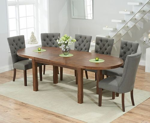 Dark oak dining table and 8 grey fabric chairs
