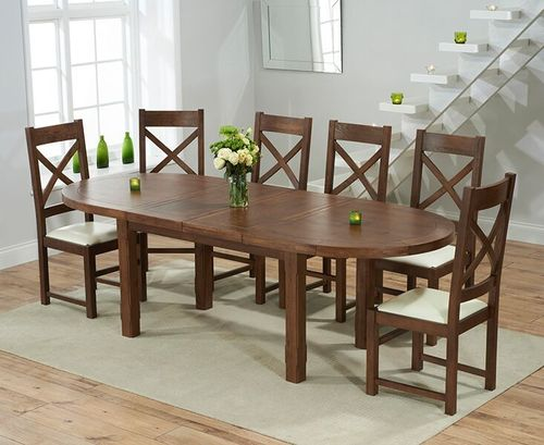 Extending dark oak dining table and 8 cream chairs
