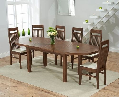 Extending dark oak dining table and 8 oak chairs