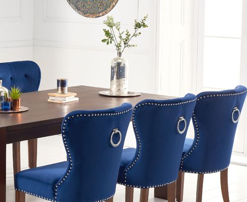 Dark oak dining table and 8 blue velvet chairs