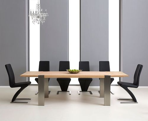 Extending oak dining table and 8 black chairs