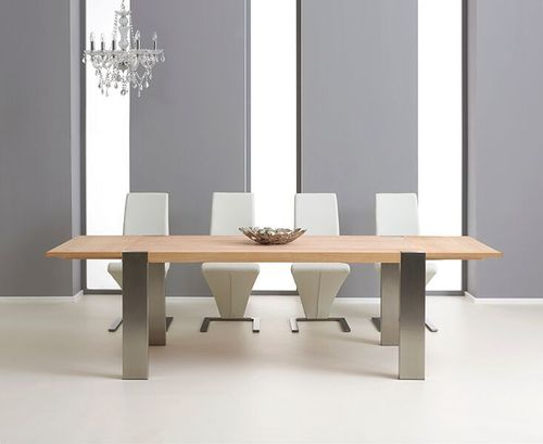 Extending oak dining table and 8 white chairs