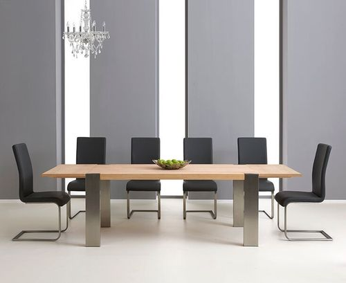 Extending oak dining table and 8 grey chairs chairs