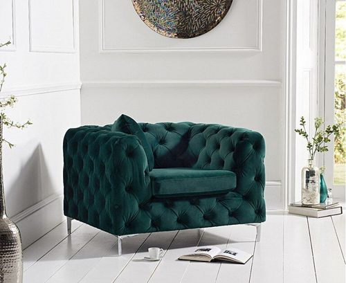 Green velvet plush armchair