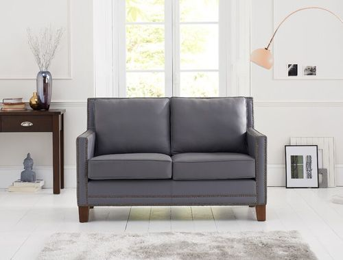 Grey 2 seater leather sofa with stud detail