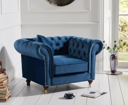 Blue velvet fabric armchair