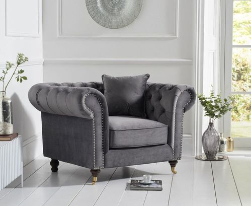 Grey velvet fabric armchair