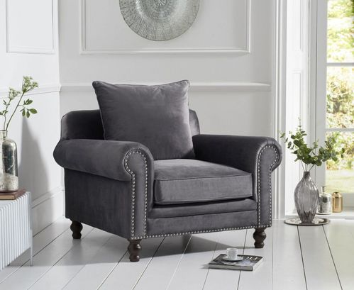 Grey plush velvet armchair with cushion