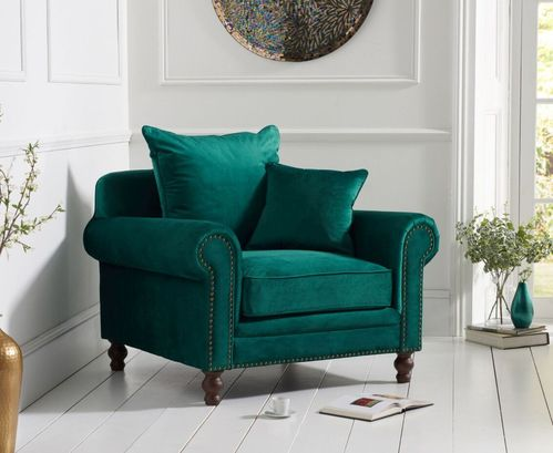 Green plush velvet armchair with cushion